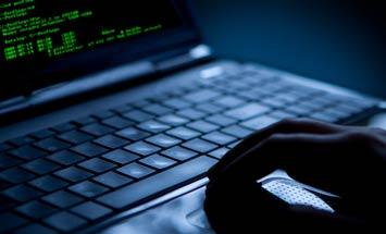 hands coding laptop
